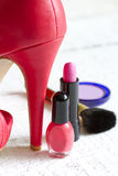 High red heels and set of cosmetics Royalty Free Stock Images