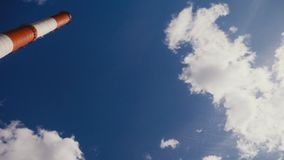 Chimney at gas and oil refinery complex and sky with clouds