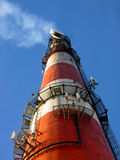 High red-white concrete industrial chimney Royalty Free Stock Image