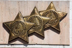 High relief of. `An award of Glory of three degrees` on Geroyev Avenue in Volgograd Royalty Free Stock Photography