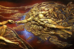 High Relief Sculpture of Greek mythology. The image pf golden High  Relief Sculpture of Greek mythology Stock Photo