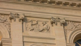 High relief wall in Versailles. Versailles palace high relief wall with two babies, one holding a mask stock video footage