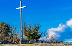 High religious cross on rural hill stock image