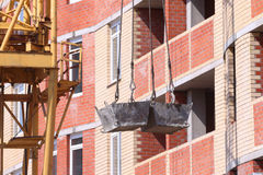 High residential building and hooks of crane Stock Photography