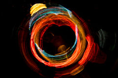 High resolution Abstract glowing circle motion blurred background in dark vivid red, green, yellow, blue Royalty Free Stock Image