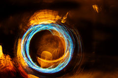 High resolution Abstract glowing circle motion blurred background in dark vivid red, green, yellow, blue Royalty Free Stock Photography