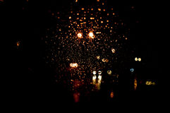 High resolution Abstract glowing rain drops blurred background in dark Royalty Free Stock Image