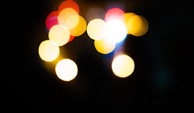 High resolution Abstract glowing rounds blurred background in dark Royalty Free Stock Images