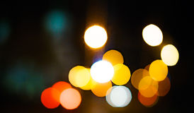 High resolution Abstract glowing rounds blurred background in dark Stock Photography