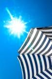 High resolution beach umbrella on blue sky background Stock Image