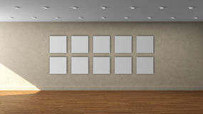 High resolution beige wall empty interior template with 10 white color square frame on front wall. royalty free stock photo