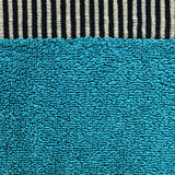 Cotton Fabric Texture - Aqua with Black & White Stripes. High resolution close up of aqua cotton fabric with a zebra crossing black & white line crossing it Royalty Free Stock Photography