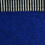 Cotton Fabric Texture - Blue with Black & White Stripes. High resolution close up of blue cotton fabric with a zebra crossing black & white line crossing it Royalty Free Stock Image
