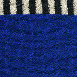 Cotton Fabric Texture - Blue with Black & White Stripes. High resolution close up of blue cotton fabric with a zebra crossing black & white line crossing it Stock Photos