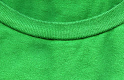 Cotton Fabric Texture - Bright Green with Collar. High resolution close up of bright green cotton fabric with part of a shirt's collar crossing Royalty Free Stock Photography