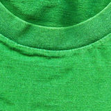Cotton Fabric Texture - Bright Green with Collar. High resolution close up of bright green cotton fabric with part of a shirt's collar crossing Royalty Free Stock Images