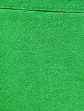 Cotton Fabric Texture - Bright Green with Seams. High resolution close up of bright green cotton fabric with two seams crossing Royalty Free Stock Photos