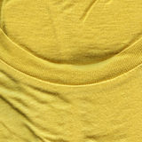 Cotton Fabric Texture - Bright Yellow with Collar. High resolution close up of bright yellow cotton fabric with collar Stock Images