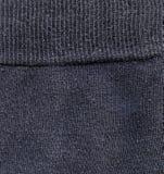 Fabric Texture - Dark Gray with Seam. High resolution close up of dark gray fabric with seam crossing Royalty Free Stock Photos