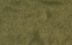 Cotton Fabric Texture - Olive Green. High resolution close up of dark olivegreen cotton fabric Royalty Free Stock Photo