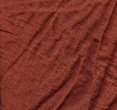 Cotton Fabric Texture - Brown. High resolution close up of green cotton fabric with two seams crossing Stock Image