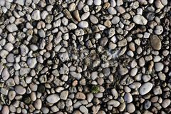 High resolution close up surface texture of gravel on the ground with high detail. Found in germany stock photography