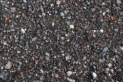 High resolution close up surface texture of gravel on the ground with high detail. Found in germany royalty free stock photo