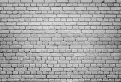 Old brick wall background in black and white. High resolution full frame background of detailed old brick wall in black and white with vignetting royalty free stock photo