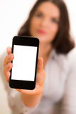 Beautiful young business women with iphone mobile device. A high resolution image of a beautiful young business woman with iphone mobile device Royalty Free Stock Image