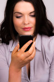 Beautiful young business women with iphone mobile device Stock Photos