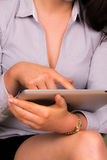 Beautiful young female using an ipad tablet device Stock Images