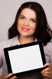 Beautiful young female using an ipad tablet device Royalty Free Stock Image