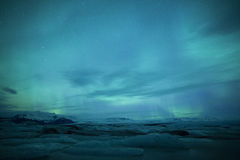 Northern lights above a lagoon in Iceland Stock Photography