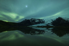 Northern lights above a lagoon in Iceland Stock Images