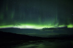 Northern lights above a lagoon in Iceland Royalty Free Stock Images