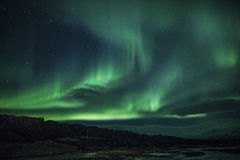 Northern lights above a lagoon in Iceland Stock Image