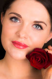 Beautiful young female with rose Royalty Free Stock Photo