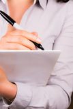 Young Professional female taking notes. A high resolution image of a Young Professional female taking notes Stock Image