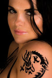Young sexy women with a tattoo on her shoulder Stock Photos
