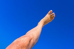 High resolution male leg on blue sky background. Male leg on blue sky background Royalty Free Stock Photography