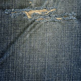 Denim Fabric Texture - Ripped Worn Out Blue Stock Photo
