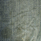 Denim Fabric Texture - Worn Out Royalty Free Stock Photos