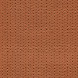 Seamless brown perforated leather texture stock image
