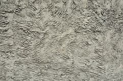 The high resolution texture of the old wall with showered plaster and clay putty. Useful for the texture of the old castle or. Walls in design, architecture and royalty free stock photography