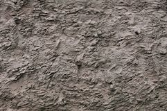 The high resolution texture of the old wall with showered plaster and clay putty. Useful for the texture of the old castle or. Walls in design, architecture and stock image