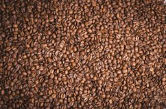 High resolution top view close up macro photo of look delicious dark roasted coffee beans, Flash light reflecting on the surface. Of the coffee beans make it stock photo