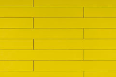 High resolution yellow plastic wall background with brick form Stock Image