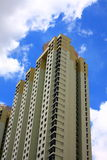 High-rise Apartment Building. Against a bright blue sky Royalty Free Stock Image