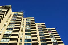 High rise apartment building. A neat high rise apartment building under the blue sky, edmonton, alberta, canada stock images