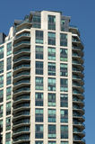 High-rise Apartment Building. Against blue sky Royalty Free Stock Photos
